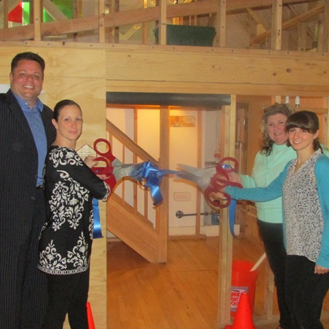 Laird Klein, president of the Staten Island Board of Realtors (SIBOR), and Traci Cangiano, immediate past president of SIBOR, participate in a ribbon-cutting ceremony with Dina Rosenthal, executive director of the Staten Island Children's Museum, and Renee Wasser, the museums' exhibits manager. The occasion marked the grand opening of the museum's newly refurbished House About It exhibit, which SIBOR helped sponsor with a $7,500 donation.