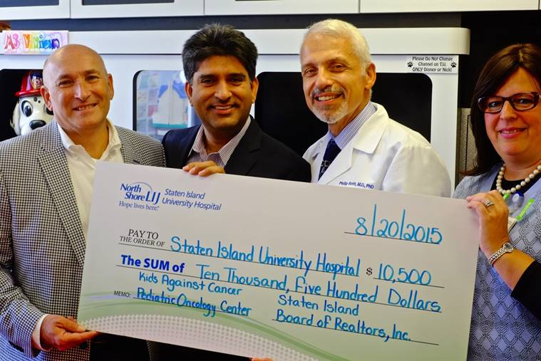 Funds raised from the 2015 Staten Island Board of Realtors' (SIBOR) Challenge Cup golf outing contributed toward the goal of a new pediatric-oncology center on Staten Island. From left, Ron Molcho, a SIBOR director and chairman of the golf outing, and Dil Gillani, 2015 president of SIBOR, presented a check for the Staten Island University Hospital Northwell Health /Kids Against Cancer pediatric-oncology center to Dr. Philip Roth, director of Neonatology and the Department of Pediatrics at SIUH, and Dr. Sarah Vaiselbuh, a pediatric hematology-oncology expert and director of the new wing at the hospital's North campus.